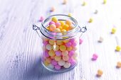 picture of sprinkling  - Colorful sprinkles on jar on table close - JPG