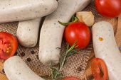 foto of raw chicken sausage  - raw chicken sausages with vegetables on board - JPG