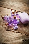 image of gels  - Bottles with purple shower gel and soap on wooden background - JPG