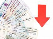 image of depreciation  - Red arrow on Russian money as depreciation of currency isolated on white - JPG