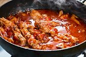 pic of stew  - Stewed chicken with spices in a tomato sauce - JPG