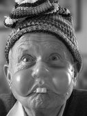 image of buck teeth  - Elderly man wearing a mask - JPG