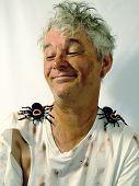 Dirty Senior Man with Pet Tarantulas
