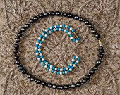 stock photo of beads  - Bead of white pearls and turquoise and bead of black pearls  - JPG