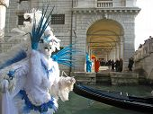 stock photo of venice carnival  - A character in a colorful costume at the carnival in Venice - JPG
