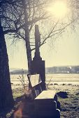 picture of crossroads  - Resting place at a crossroads of the sun lit up on a cold winter morning - JPG