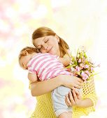 stock photo of congratulation  - Mother and Baby Family Portrait with Flowers Little Kid Embracing Mom Child Congratulate Mothers Dat and Love Concept - JPG