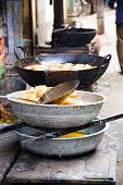 pic of rajasthani  - Indian fried besan sev snacks prepared in a stand on the street - JPG