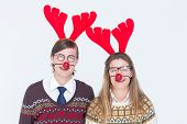 pic of headband  - Happy geeky hipster couple with stag headband on white background - JPG
