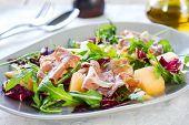 stock photo of rocket salad  - Prosciutto with rocket cantaloupe and radicchio salad - JPG
