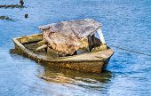 picture of wrecking  - A decaying wreck of a boat covered with barnacles rests in the harbor near Beaufort North Carolina - JPG