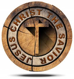 stock photo of christianity  - Wooden Christian cross on a section of tree trunk and text Jesus Christ the savior - JPG