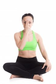 picture of pranayama  - Serene beautiful girl practicing yoga nadi shodhana pranayama  - JPG