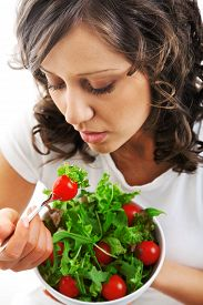 image of youg  - Youg woman eating healthy salad isolated on white background - JPG
