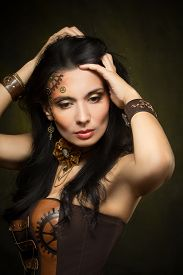 stock photo of steampunk  - Portrait of a beautiful steampunk woman over dark background - JPG