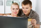 picture of antidepressant  - Family couple shopping over internet looking in notebook and paying with credit card - JPG