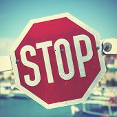 picture of traffic sign  - Stop traffic sign on the barrier - JPG