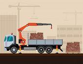 stock photo of construction crane  - Crane truck loading a pack of bricks on construction background - JPG