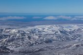 picture of iceland farm  - Aerial view of showy mountains during winter - JPG
