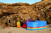 Beach Tent With Colourful Windbreaker And Wetsuits