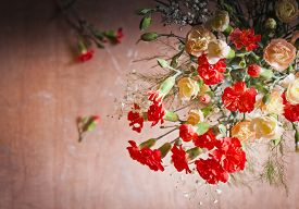 pic of carnations  - Carnations and gypsophelia showing dark feelings sadness and depression - JPG
