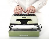 detail of man with typewriter selective focus image