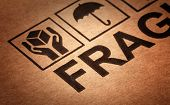 fine image close up of fragile symbol on cardboard selective focus