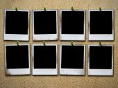 eight photo frames on grunge wall