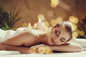 Massage. Beautiful girl in spa salon poster