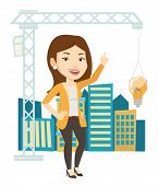 Caucasian woman pointing at idea light bulb hanging on crane. Architect having idea in town planning poster