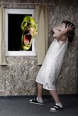 Screaming green zombie and fright little girl - green wooden head is unauthorized homemade work Grea