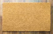 Blank Welcome Mat On Wood Floor Background Ready For Your Own Text. poster