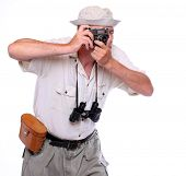 Photographer with camera dressed on safari suit Studio shot isolated on white