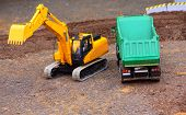 Green dumper and yellow excavator on a road building. Homemade RC model - plastic kit (  scratchbuil