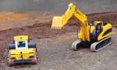 Yellow excavator on a road building. Homemade RC model - plastic kit ( scratchbuild 1 : 32 scale)