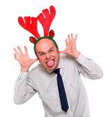 Crazy businessman with reindeer attire. Funny image great for christmas and new year greetin