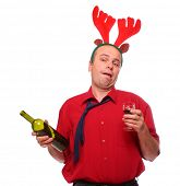 Drunken businessman with reindeer attire holding vine bottle. Funny image great for christmas and ne