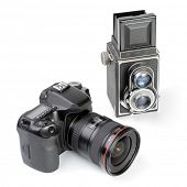 Modern dslr camera and vintage medium format two-lens camera. Picture of evolution in photographic t