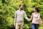 love, relationship, family and people concept - happy couple walking in summer park poster