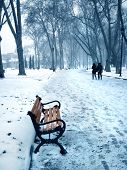 an image of a snow covered empty bench
