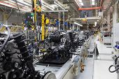 Assembly Of Motor Vehicle. Robotic Equipment Makes Assembly Of Car. Modern Car Assembly At Factory poster