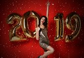 Cheerful Happy Beautiful Young Woman Is Smiling On Party With Gold 2019 Balloons. Party, Holiday, Ch poster