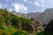 Subtropical Mountain Landscape With Rocky Ridges And Vegetation-covered Rocks poster