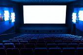 Dark blue rows of theater seats