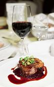 pic of chateaubriand  - Tenderloin steak with red sauce on arranged table - JPG