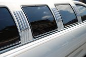 Window and roof of the white limousine