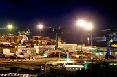 picture of railroad yard  - Port warehouse with cargoes and containers at night - JPG