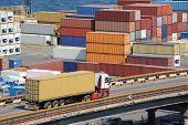 stock photo of railroad yard  - truck transports container to a warehouse near the sea - JPG