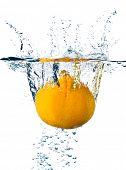 Orange splashing water isolated on white