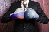 Businessman In Boxing Gloves With Russian And European Union Flag. Russia Versus European Union Conc poster